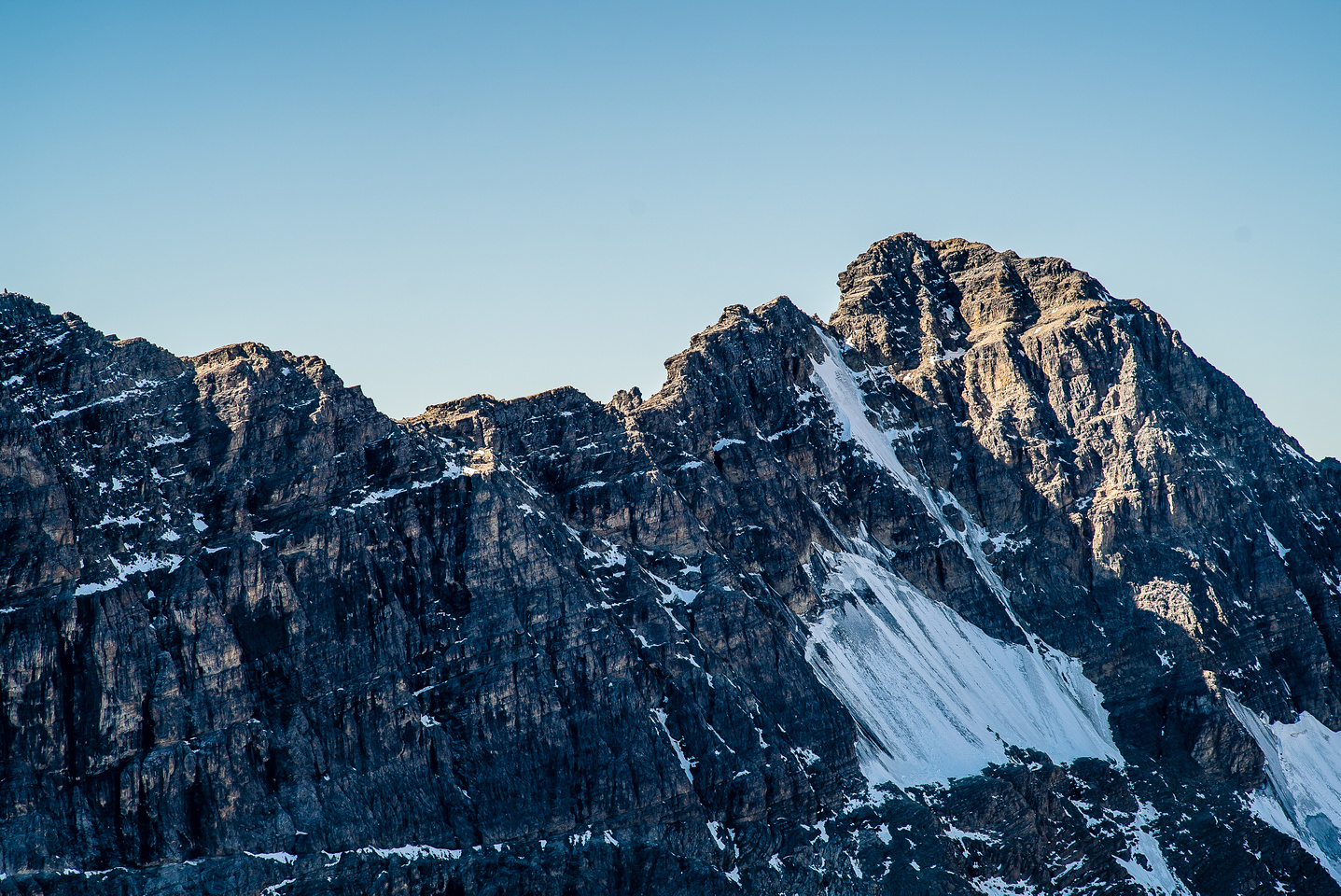 A closeup view of the difficult ridge and summit block of White Man Mountain.