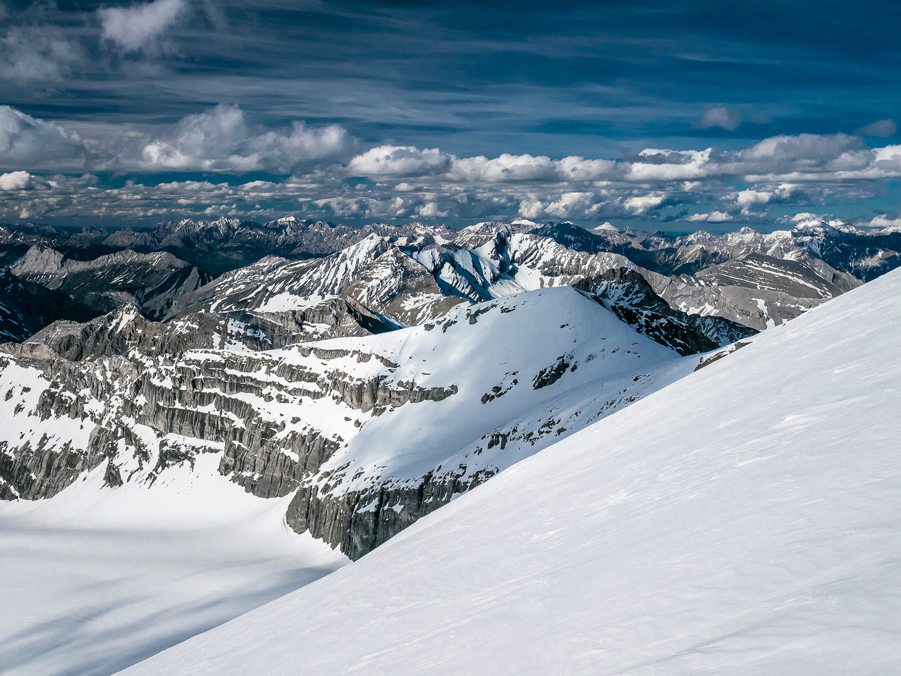 Looking over the false summit and north ridge. The snow gully at lower left of center must be the optional route when the north face is too icy.