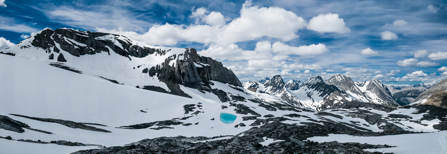 There were some small, brilliant blue tarns on the Mangin Glacier. This is looking back at Cordonnier (L) and Northover / Lyautey