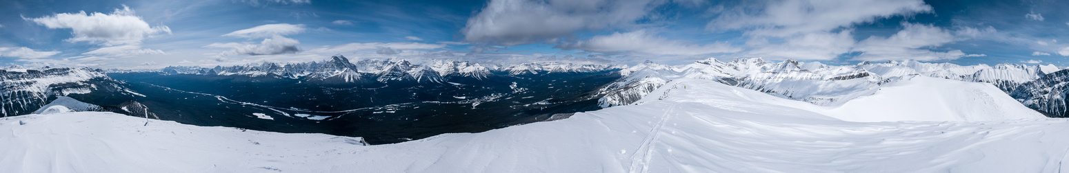 Huge panorama with Protection Mountain at left, Lake Louise at center and Purple Mound at right.