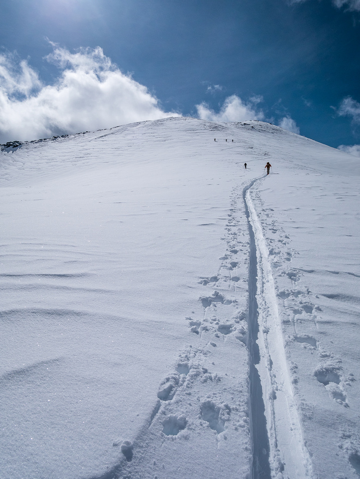We follow the 3 others skiers up Purple Mound.