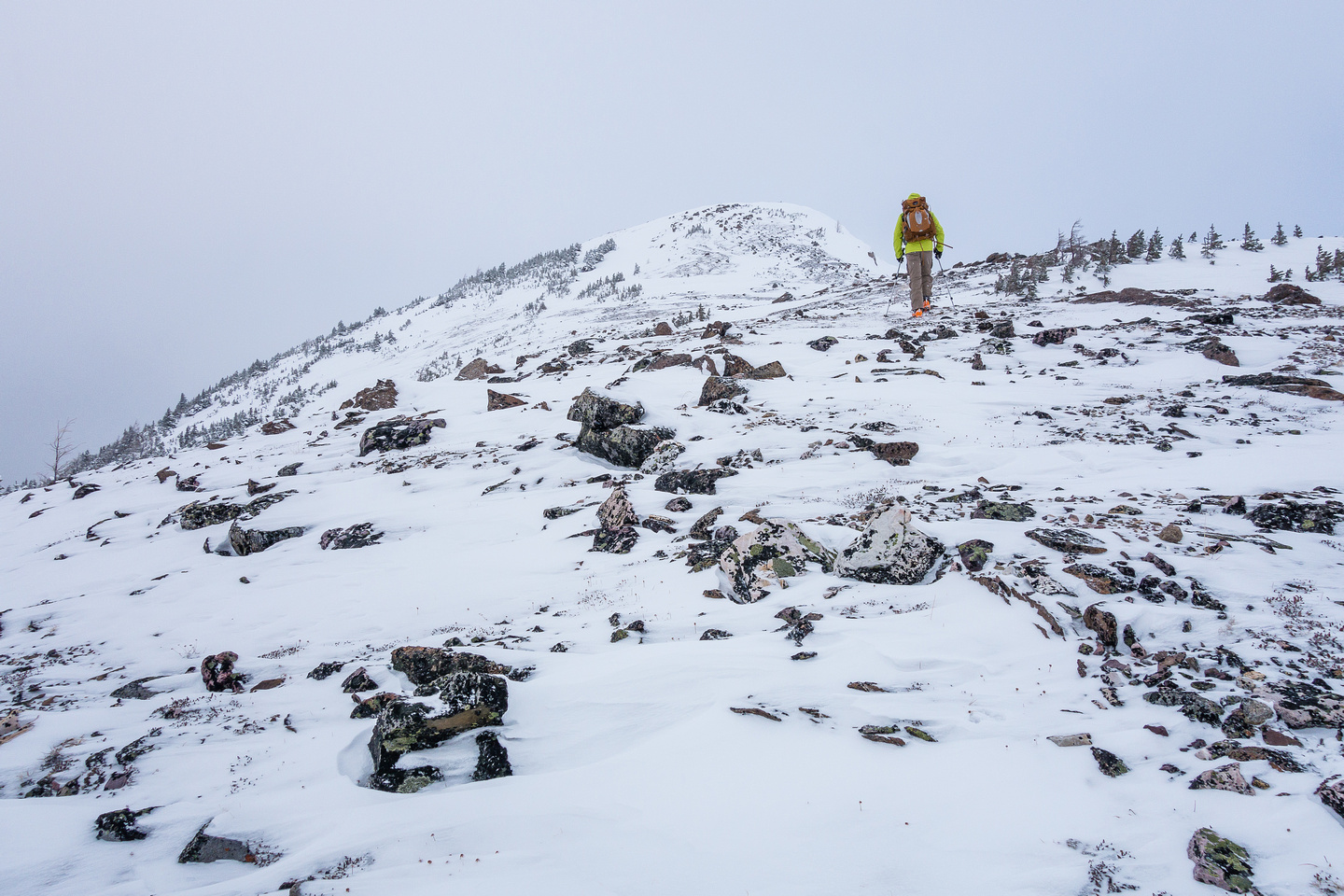 Wietse plods up scree and boulders to the summit.