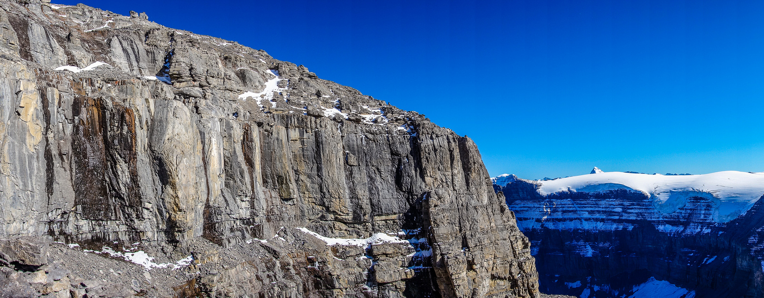 The upper cliff band is pretty much impenetrable accept for a few steep gullies / couloirs.