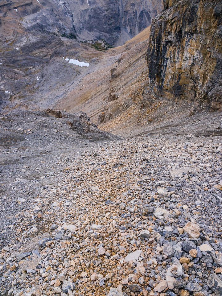 Heading down the easy scree ramp.