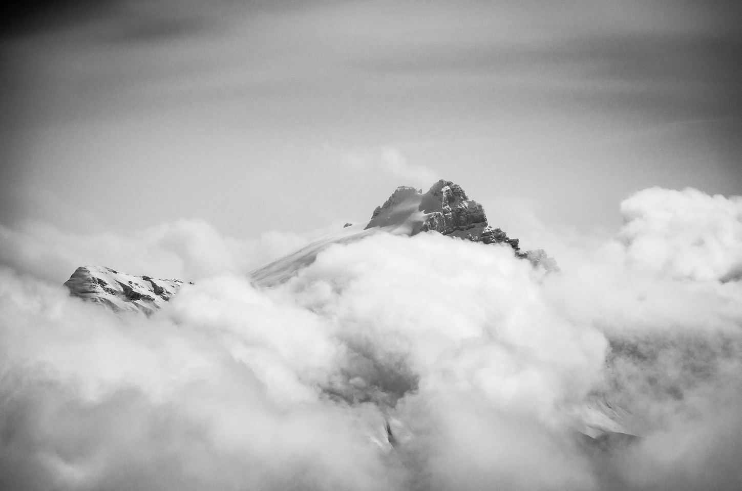 Mount Hector (R) and Little Hector (L) playing peek-a-boo amongst the clouds.