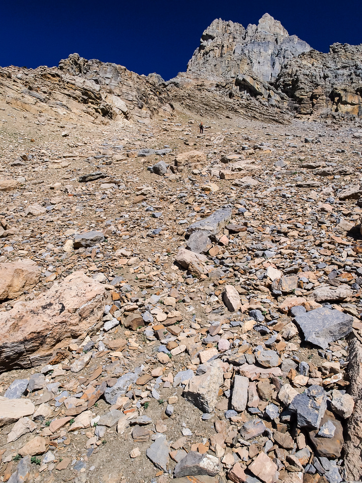 Looking left of the previous photo, Wietse is gaining height on loose scree to the upper mountain - he will soon traverse back to the right.