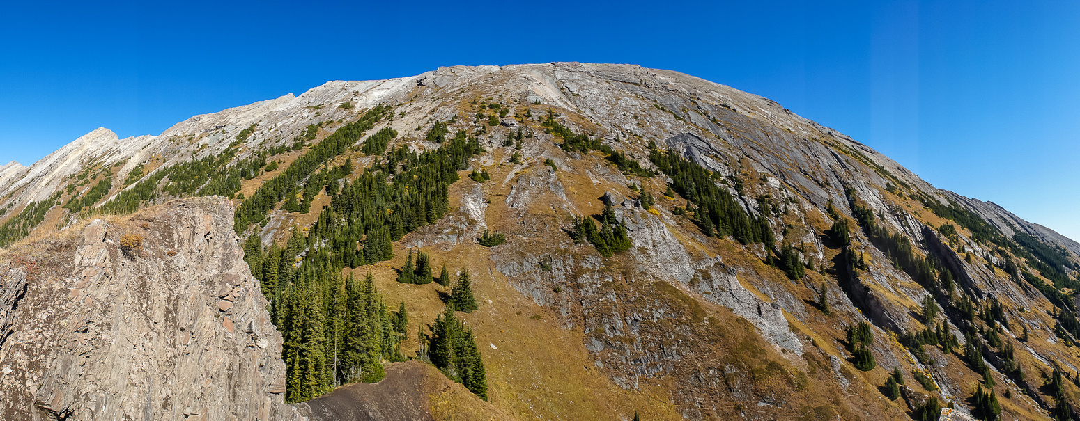 Pano of Mount Kent from the 'bump'. Our ascent route goes up the middle, or descent route is left of middle following grassy slopes.
