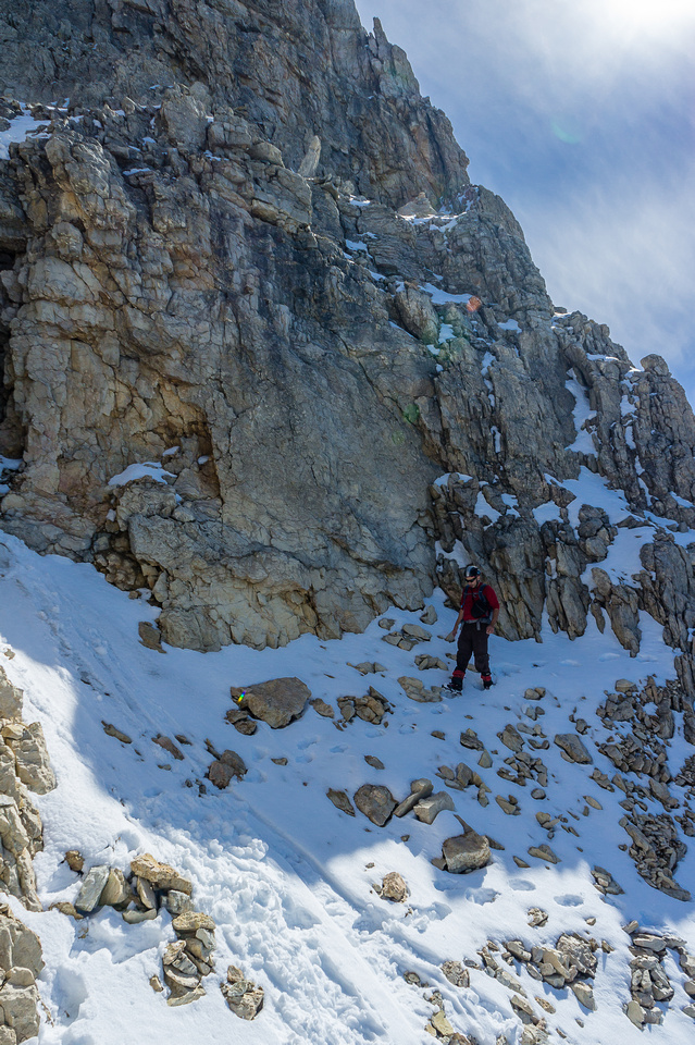 Traversing over to the last scree gully before the summit ridge.