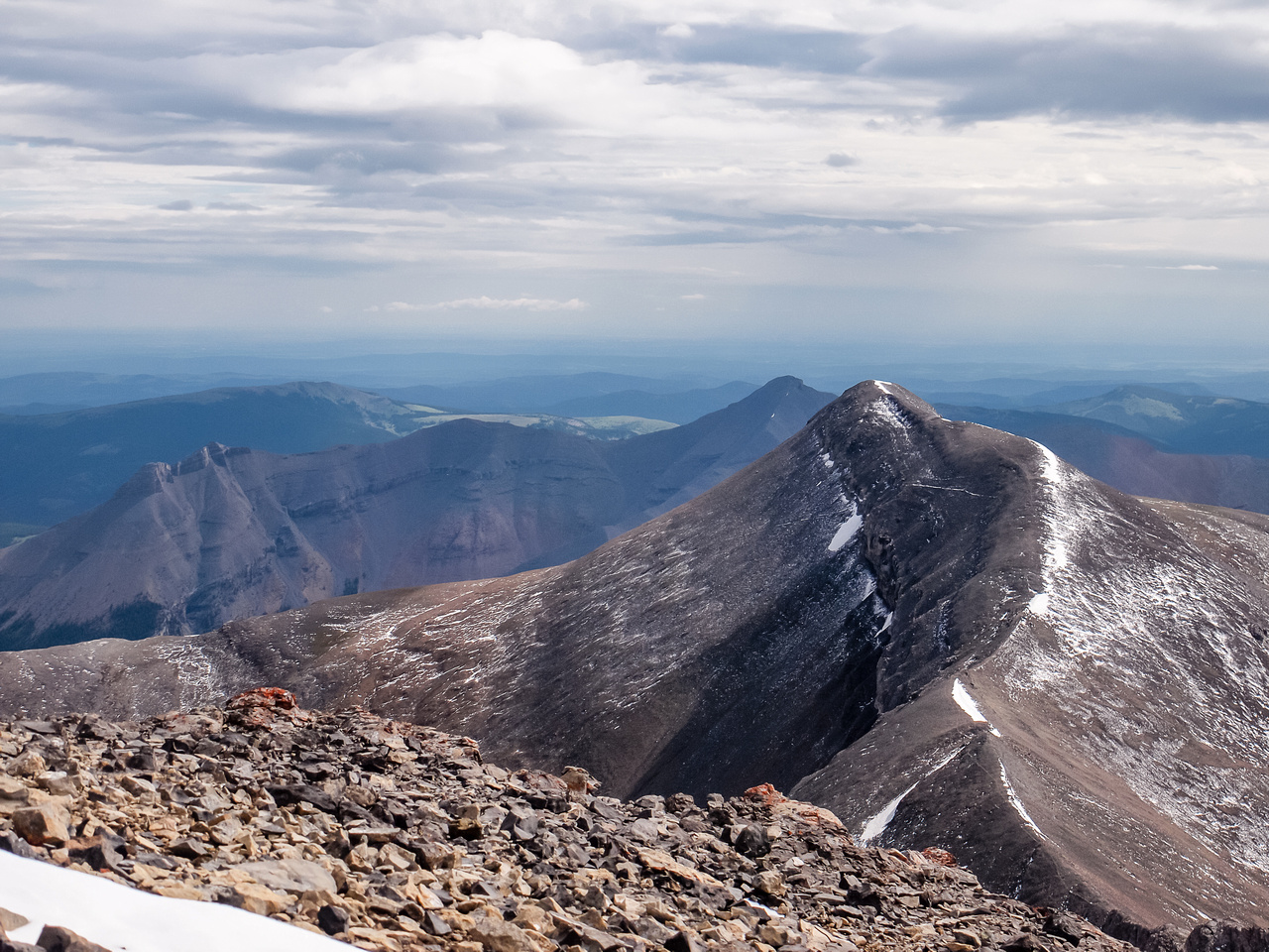 An unnamed summit with Threepoint in the distance.