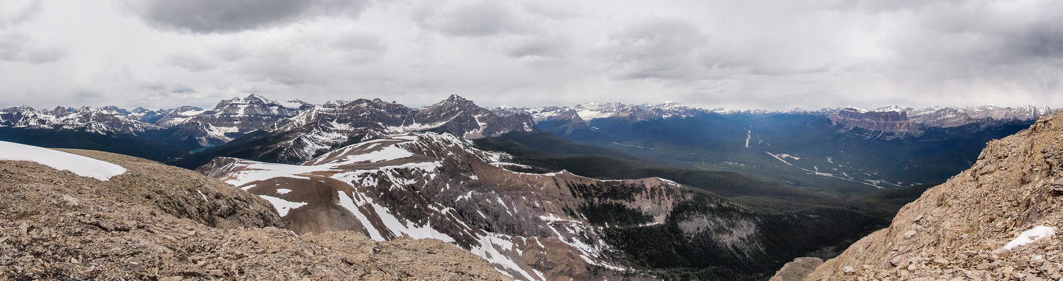 Great summit pano despite the clouds showing Ball, Stanley and Storm on the left and Castle on the right. Shadow Lake in front of Ball.
