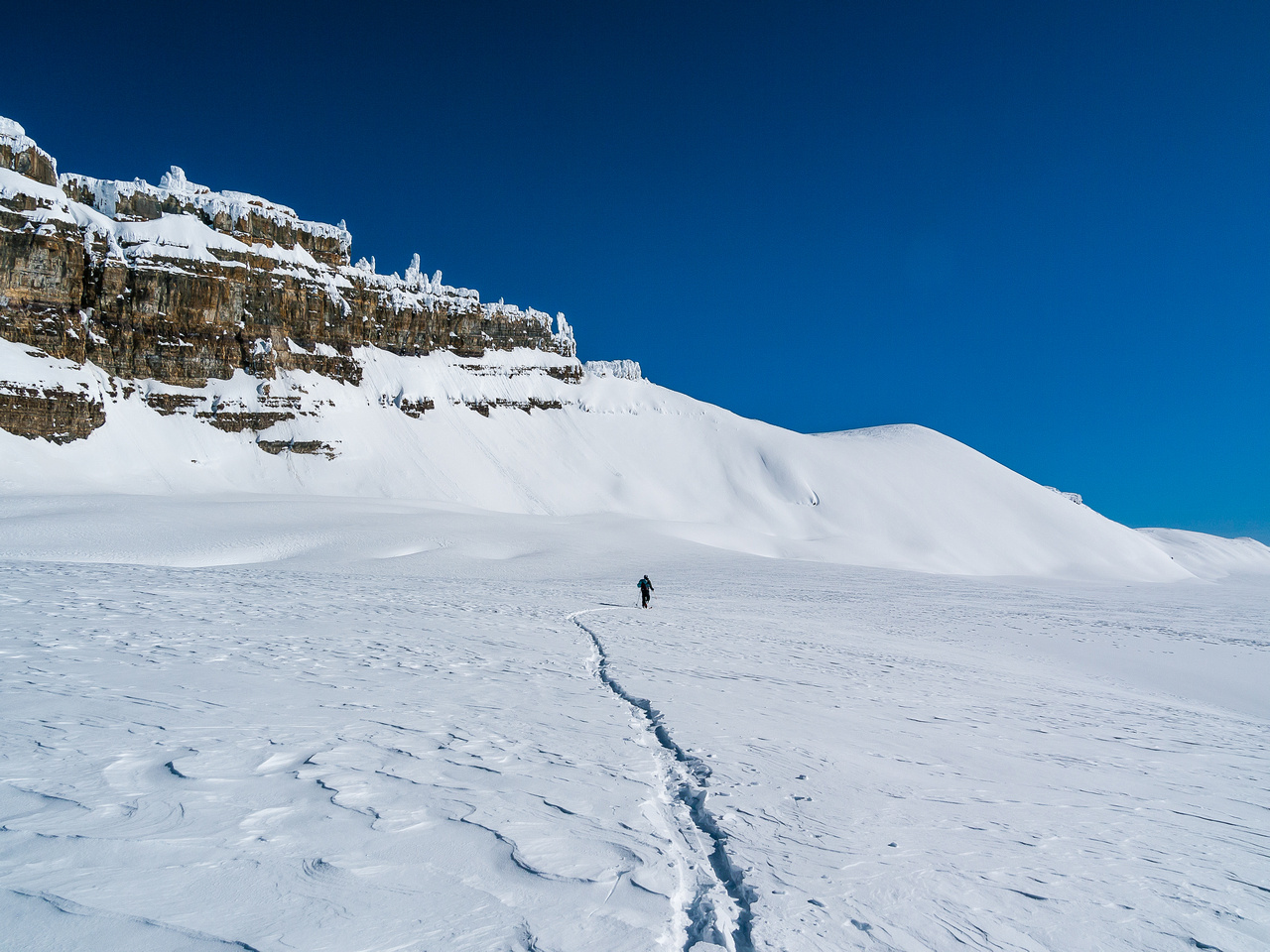 Skiing around the south end of Lilliput under its west face. Daly at right.