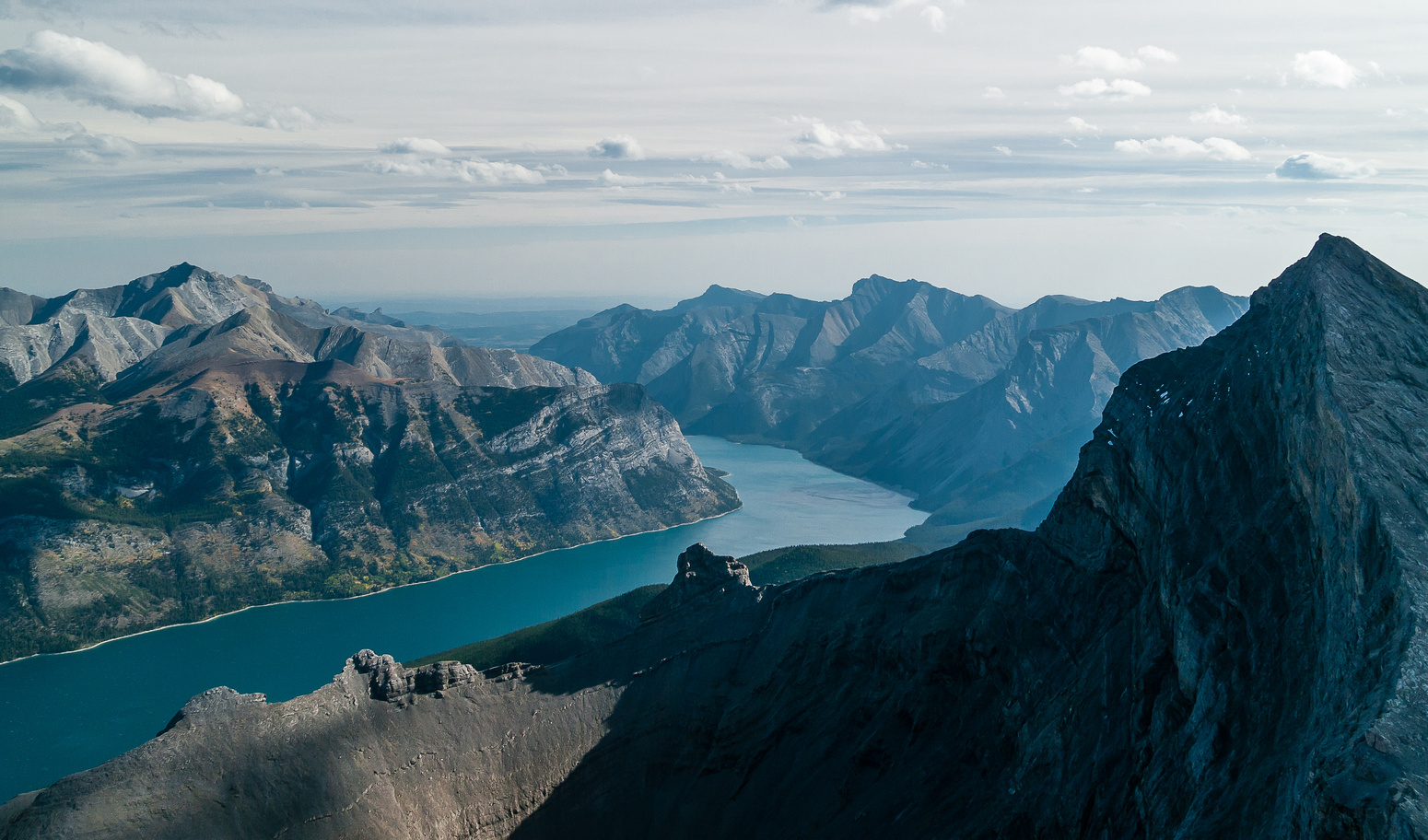 Looking down Lake Minnewanka to Costigan, Orient Point, Saddle and Girouard (R).
