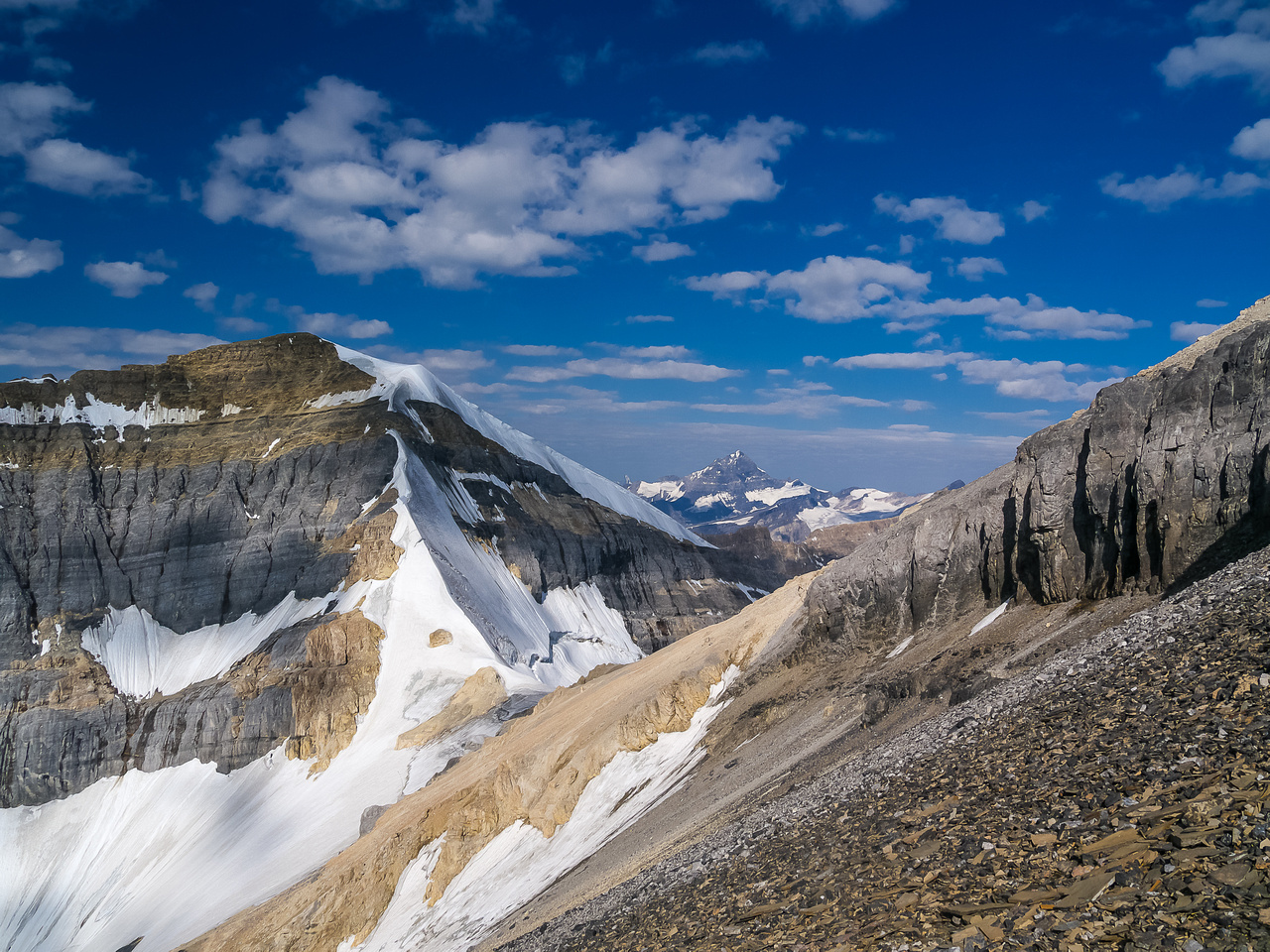 This is looking left of the previous photo at the White Pyramid col and the scree traverse around the cliff band.