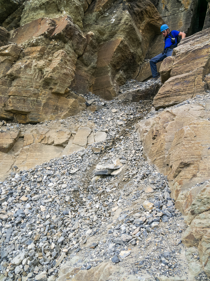 Traversing back under the crux where the rope is hanging. You can see why this is the crux!