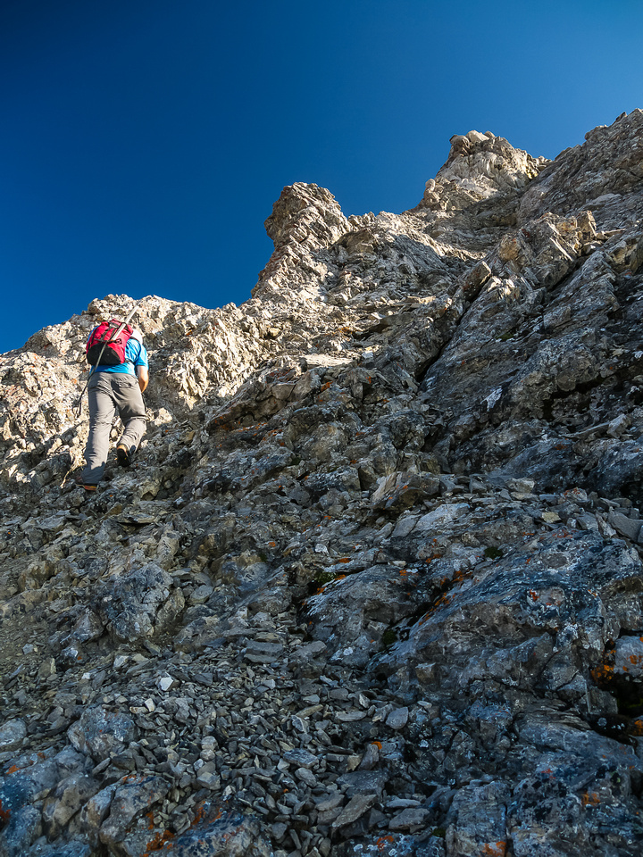 The scrambling terrain turns more serious near the summit ridge.