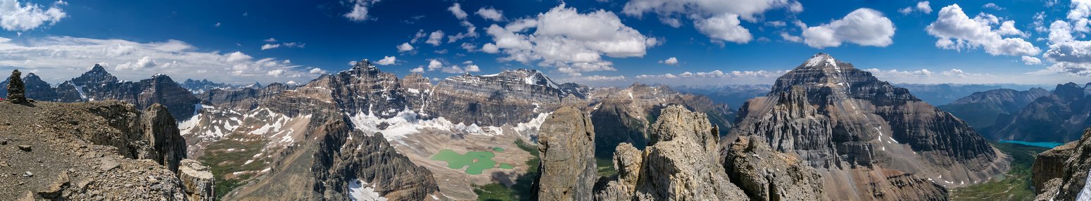 Incredible summit panorama from Deltaform (L) to Hungabee, Victoria, Lefroy (C) and Mount Temple and Moraine Lake (R).