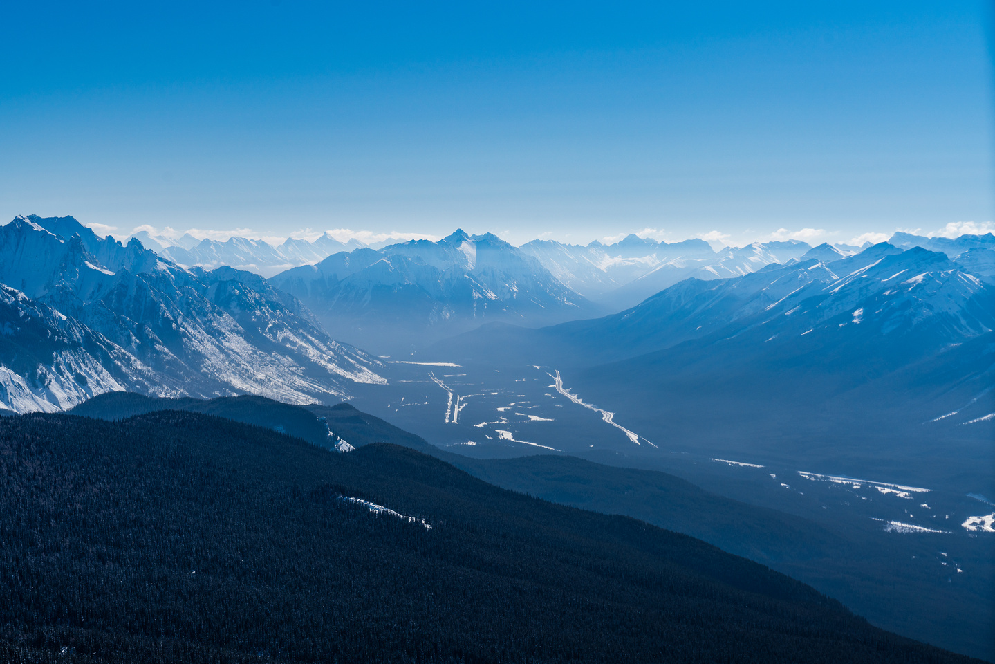 Looking through the cold winter haze towards Banff and Mount Rundle.