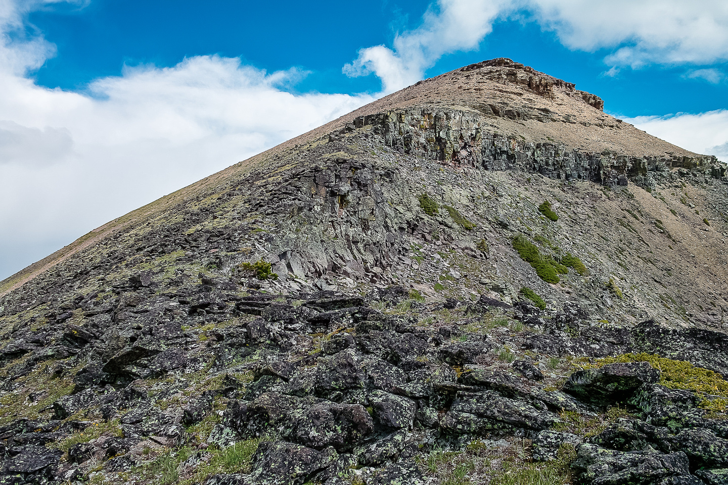 A view back to the surprisingly sunny summit of Syncline as we descend on the St. Eloi traverse.