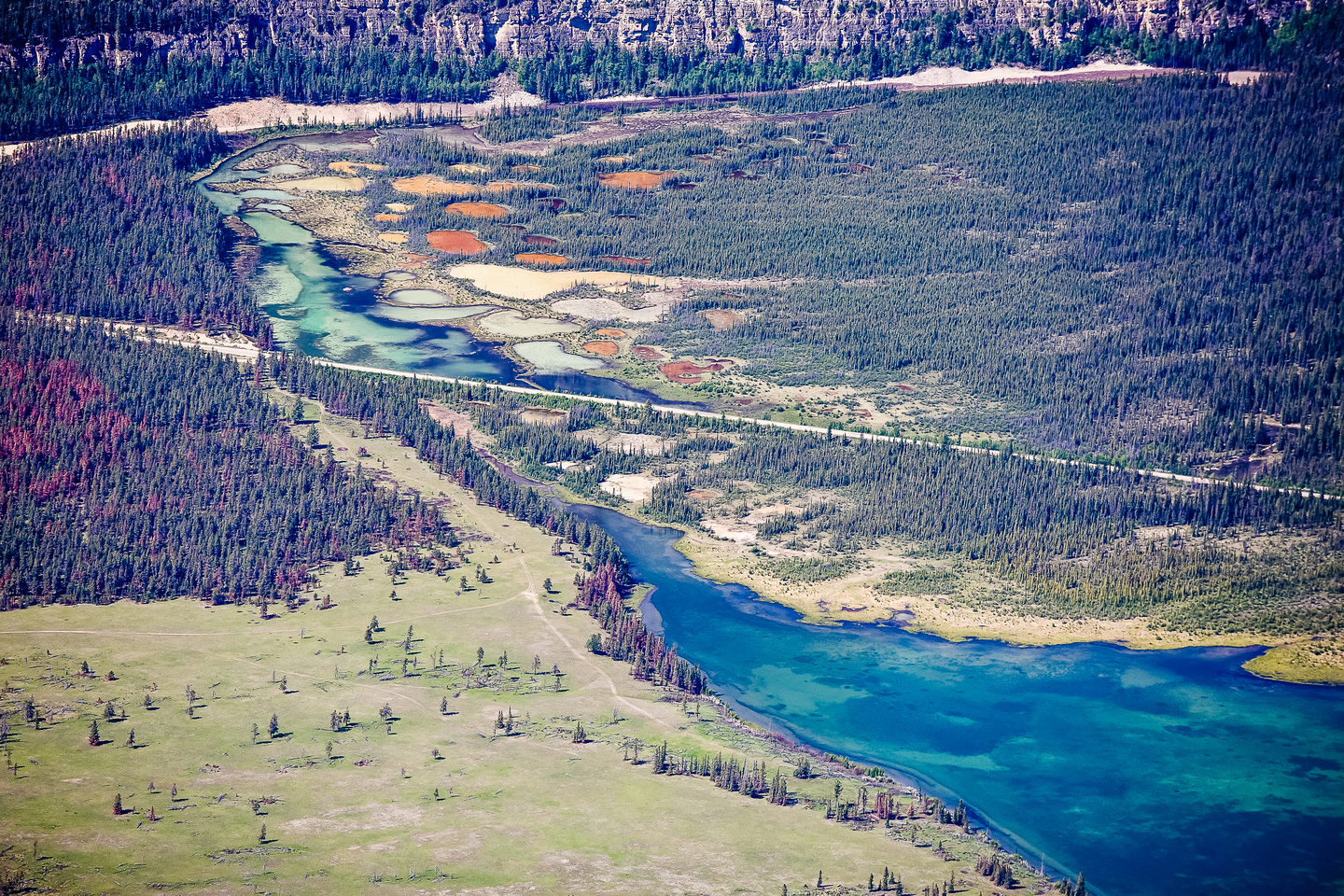 Incredible colors of the Palisade Tarns across the Athabasca River.