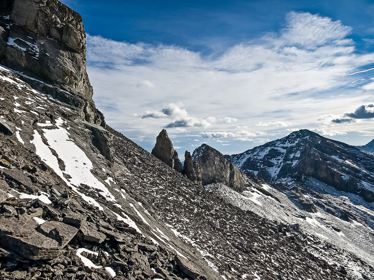 The pinnacles come into view as we round the summit block on the way back.