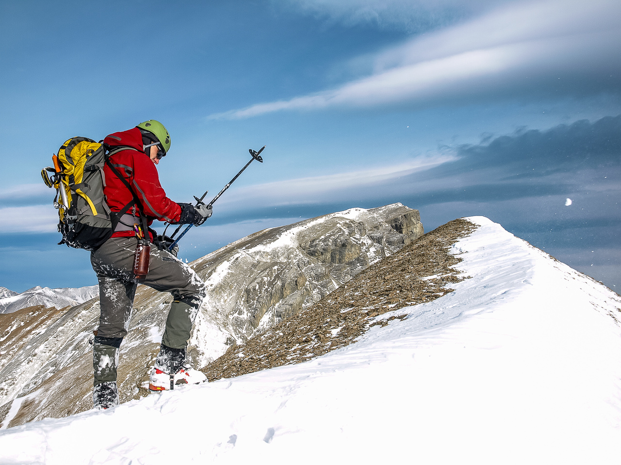TJ adjusts his poles after taking off the crampons for the final summit push. You can see the snow flying through the air - it was windy!
