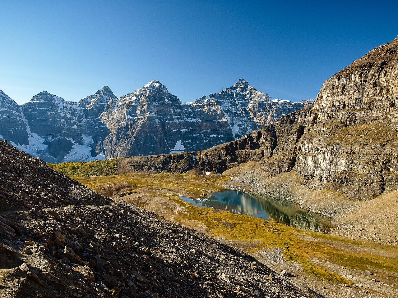 Looking down at a perfectly calm Larch Valley tarn on one of the most beautiful fall days I've ever had in the Rockies.