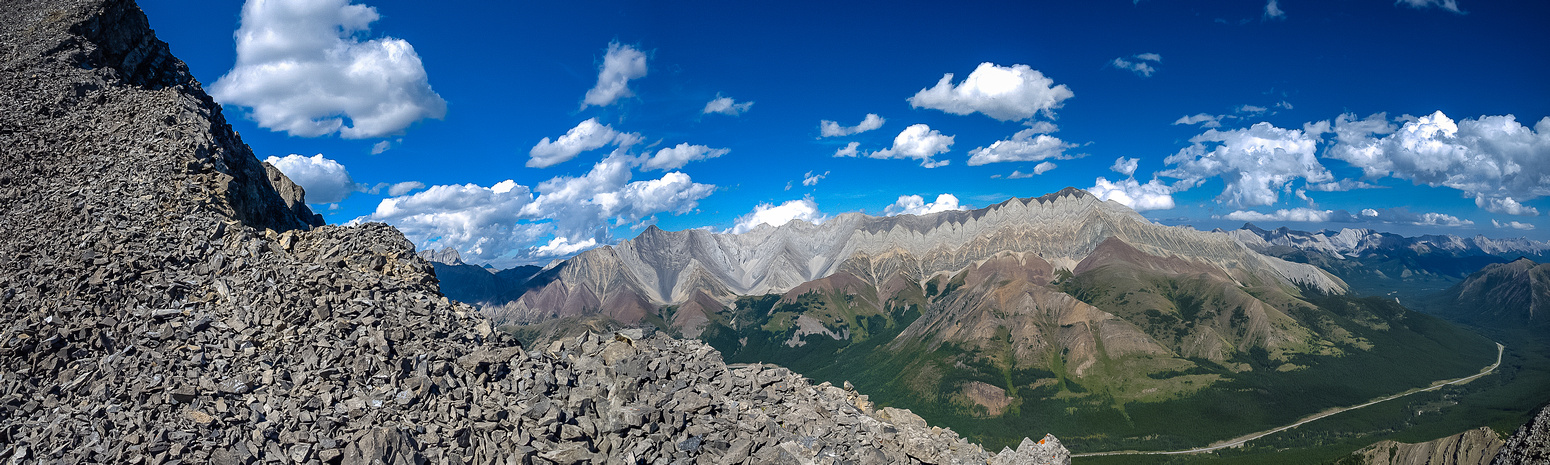 Looking off the summit ridge across hwy 40 at Storm and Mist Mountains.