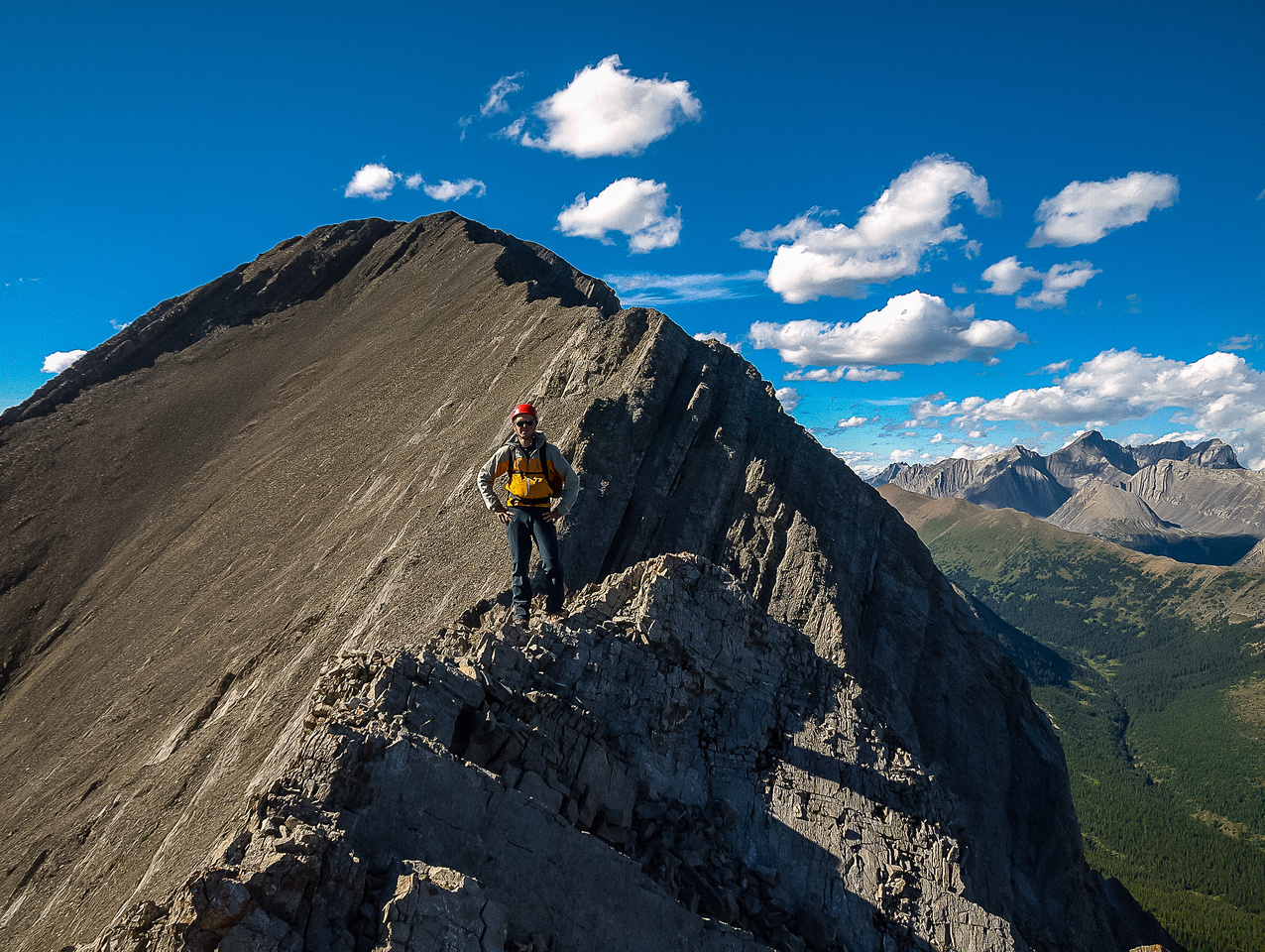 Raf on top of the east face of Storelk with the summit in the bg.