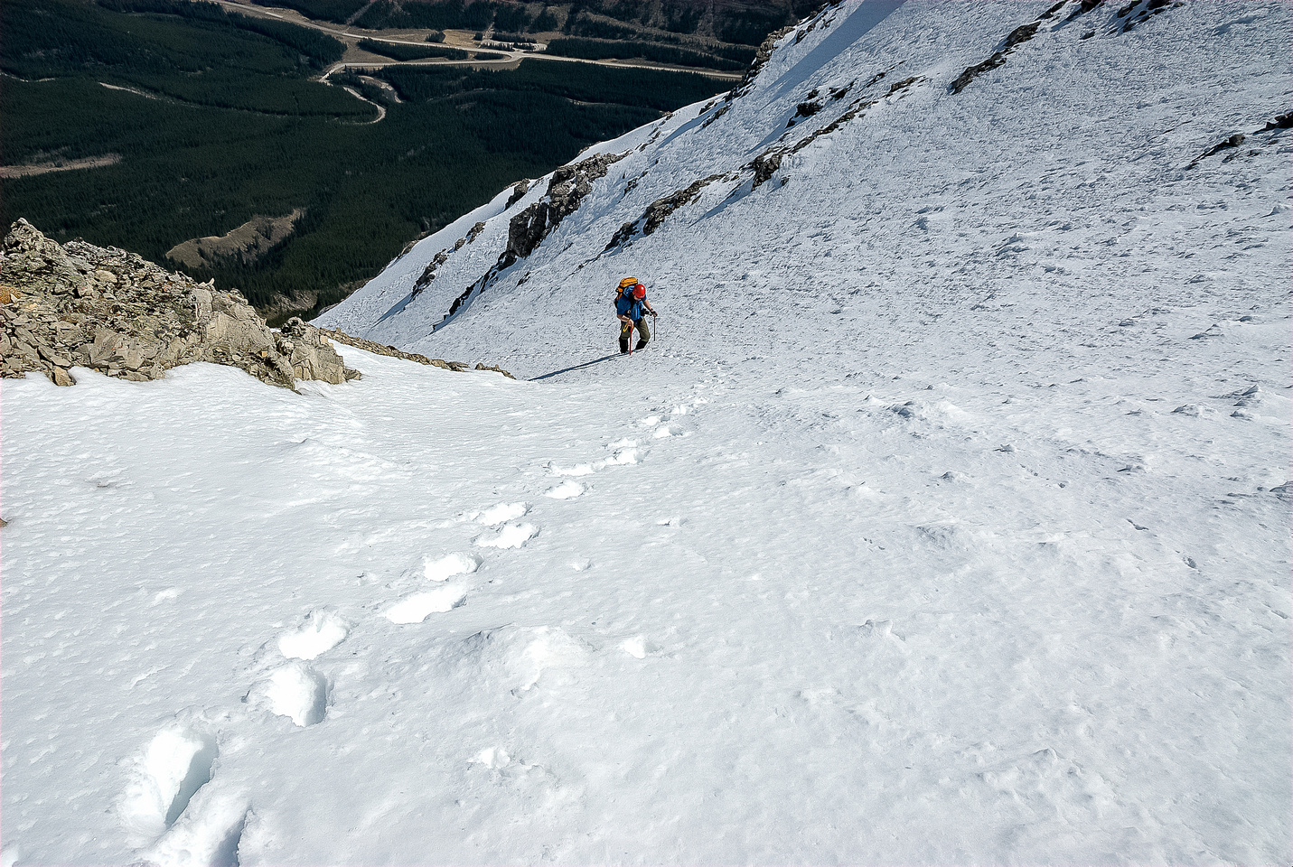 Wietse follows our steps to the col and off the north gully.