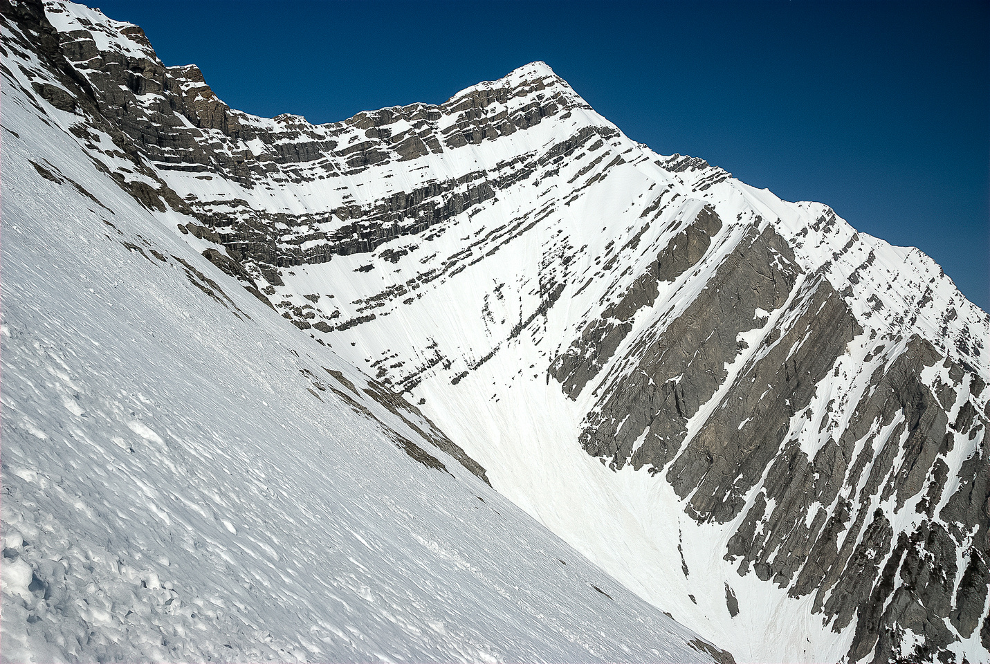 Mount Inflexible from the steep ascent slope.