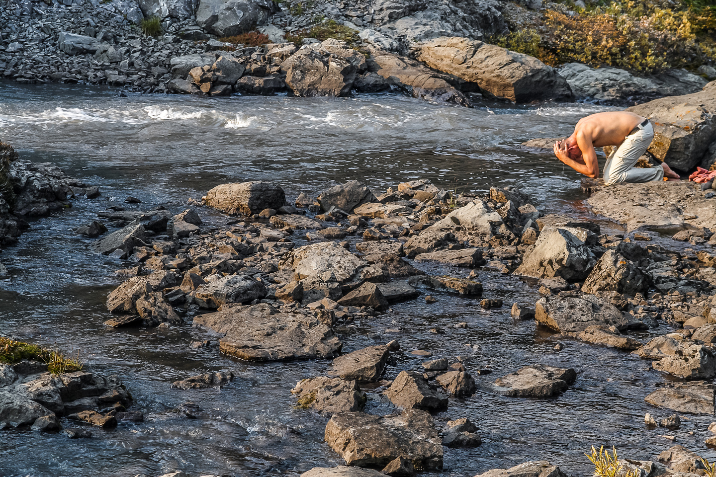 Jon cools off in Aster Creek after a long, hot day of scrambling and hiking.