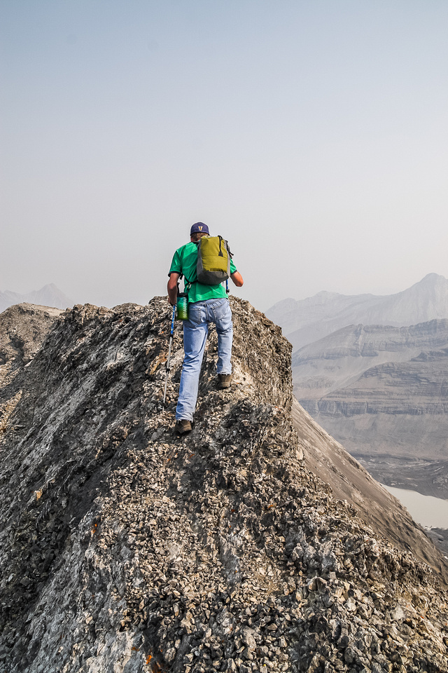 Rod navigates the narrow section of summit ridge where you can't afford to slip to either side!