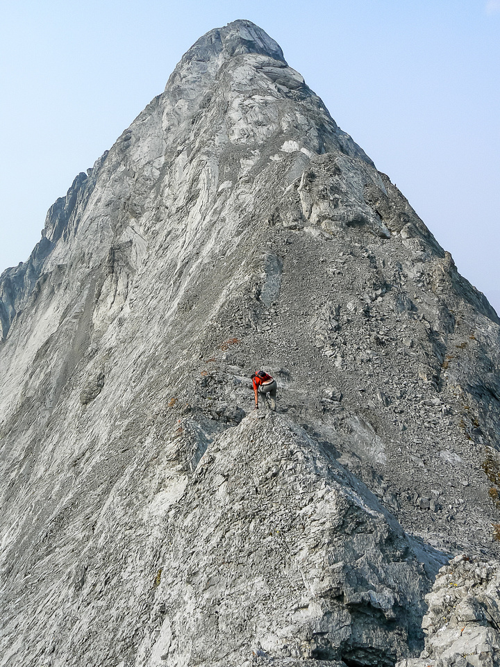 Vern delicately balances over an 'easy' section of the south ridge - compared to the crux anyway!