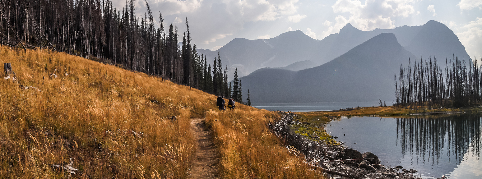 Hiking back along Upper Kananaskis Lake - back in thick smoke. Mount Sarrail and Foch at right.