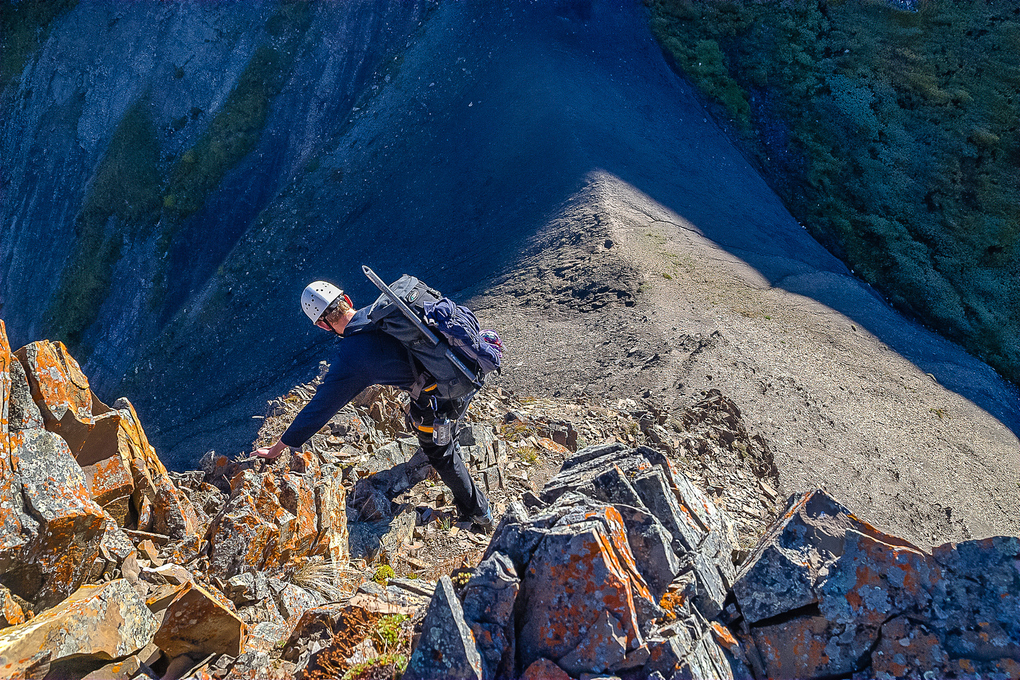 JW down climbs the nose of the dirt / dinner plate pinnacle that abuts the NW ridge of Fisher directly ahead of us here.