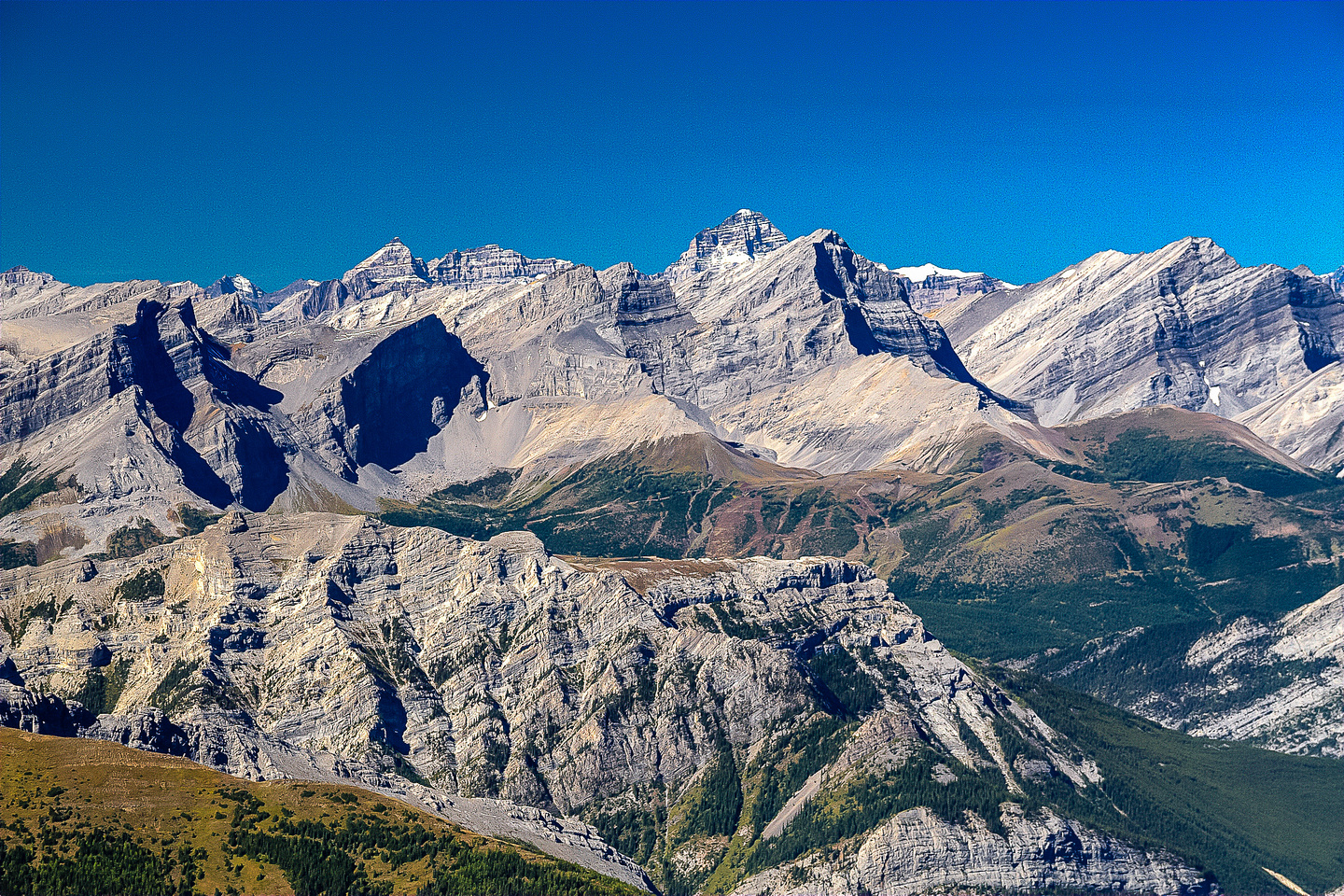 More stunning fall views towards mighty Mount Assiniboine over the line of Fortress, Gusty, Galatea and the Tower.