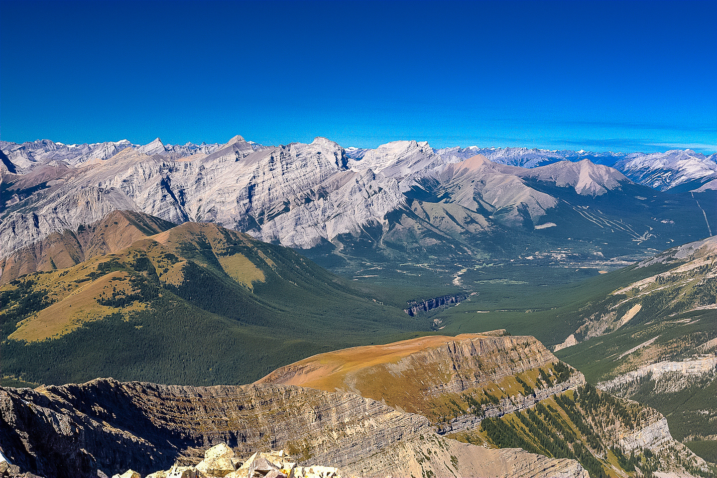 McKay Hills to the left and Nakiska Ski hill at the right with Kananaskis Village just to its left.