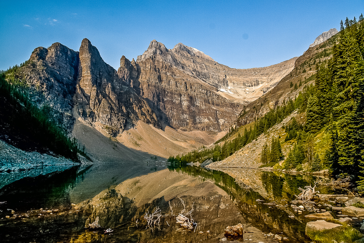 Lake Agnes reflects the surrounding terrain perfectly.