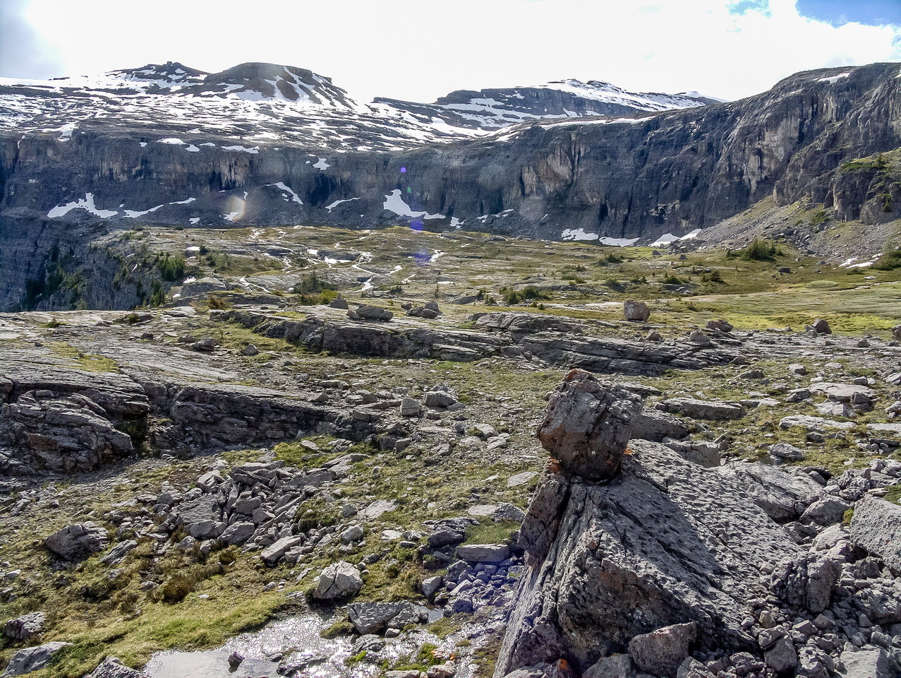 The entire second plateau from the 'bump' on Helena's slope. The ascent through the cliff band is on the far left side.