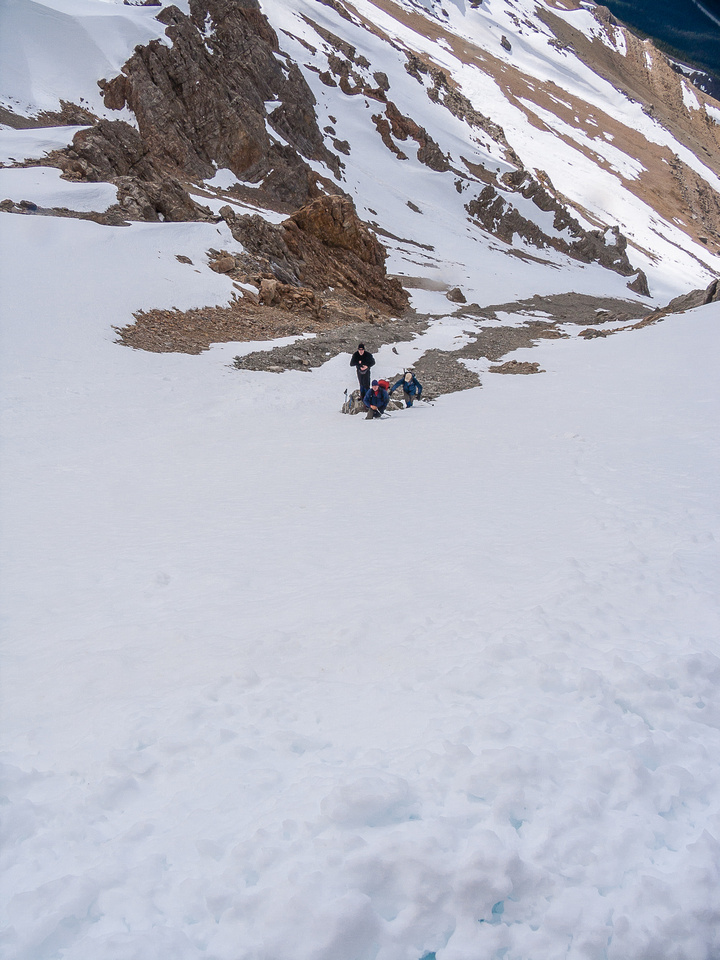 The gully steepens dramatically near the top, here the other guys prep for a steeper snow climb.