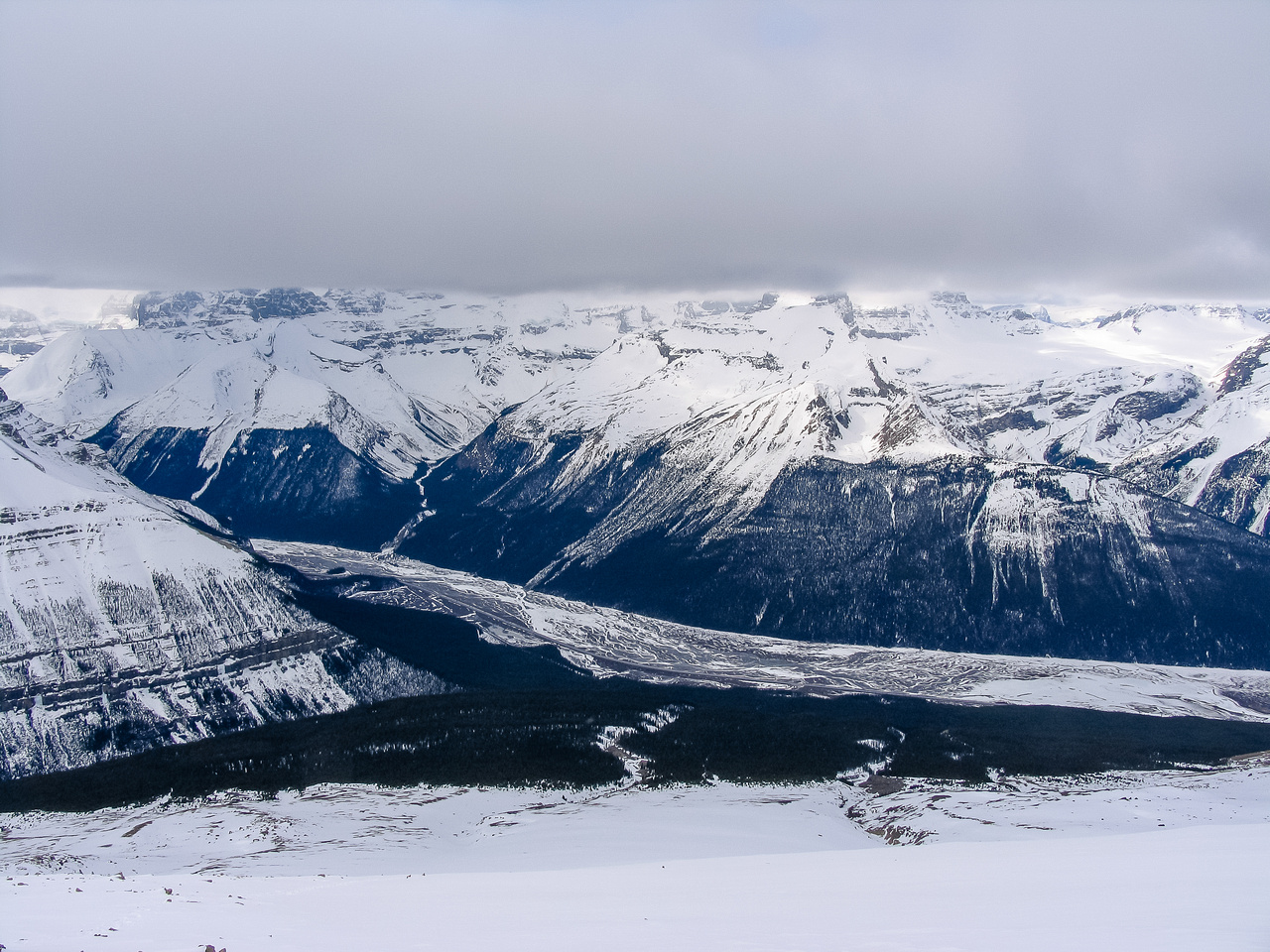 The northern end of the Columbia Icefield is hidden in clouds at left.