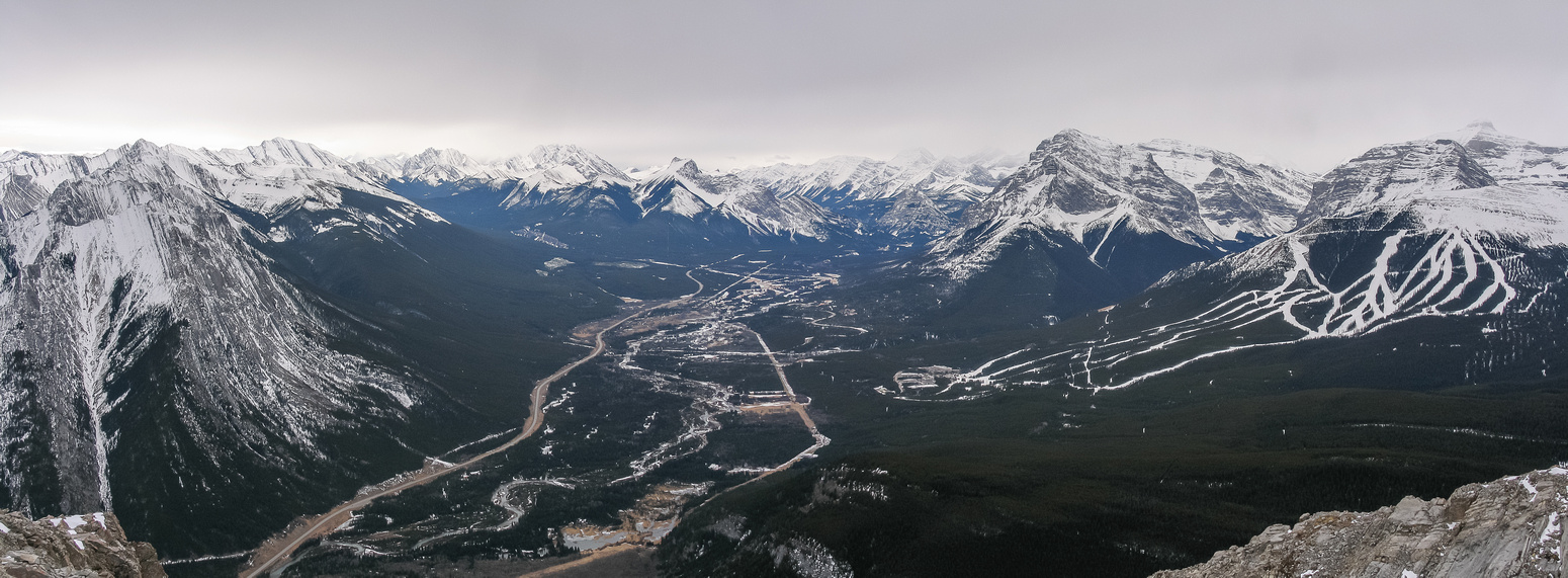 Views over Kananaskis Village include Fisher at left and Kidd and Ribbon at right.