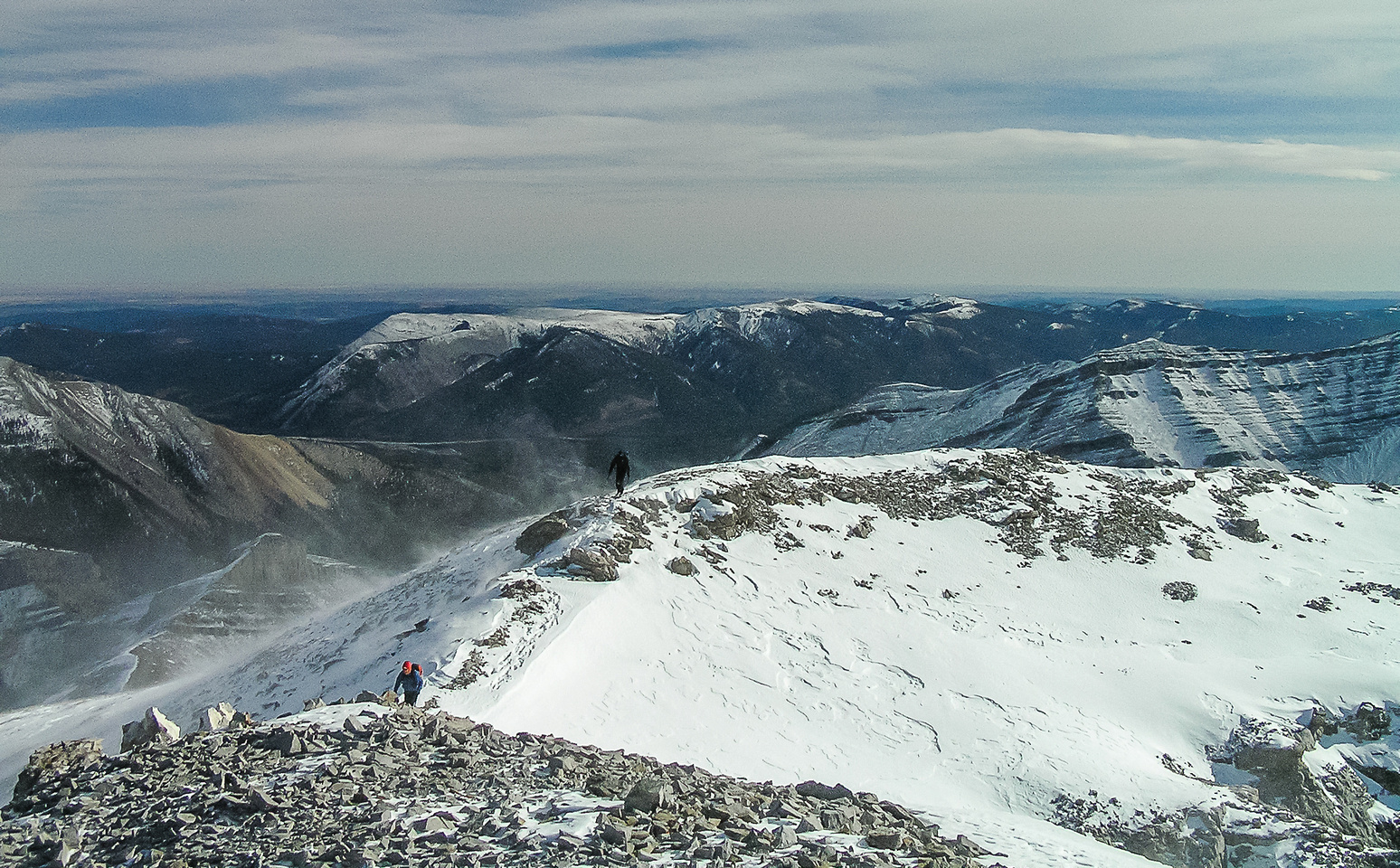 Bill and Gary make their way to the summit of Mount Remus in very strong winds.