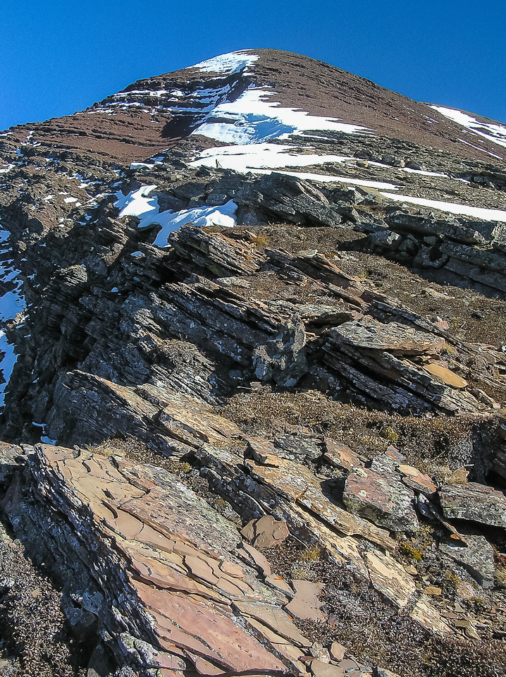 The route up the easy northwest ridge to the summit of Carthew as seen from the end of the traverse below the second cliff band.