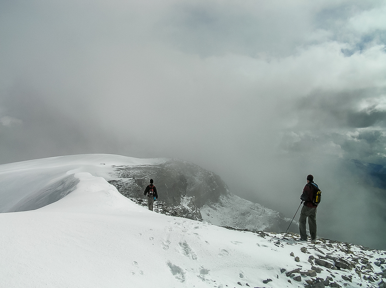 The clouds swirl around us at the summit.