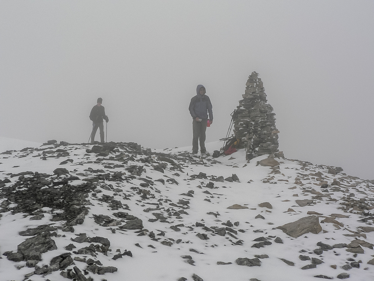 At the giant summit cairn.