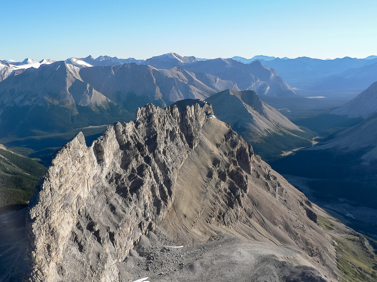 Wall of Jericho with Skoki Peak, Cyclone, Pipestone and Drummond in the distance.