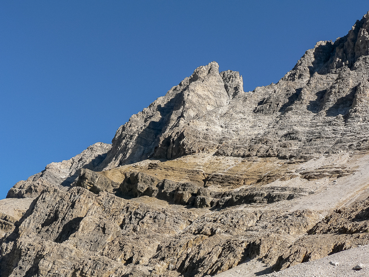 Our traverse route to Pika seen from Hidden Lake is above the cliff at mid photo casting the shadow.