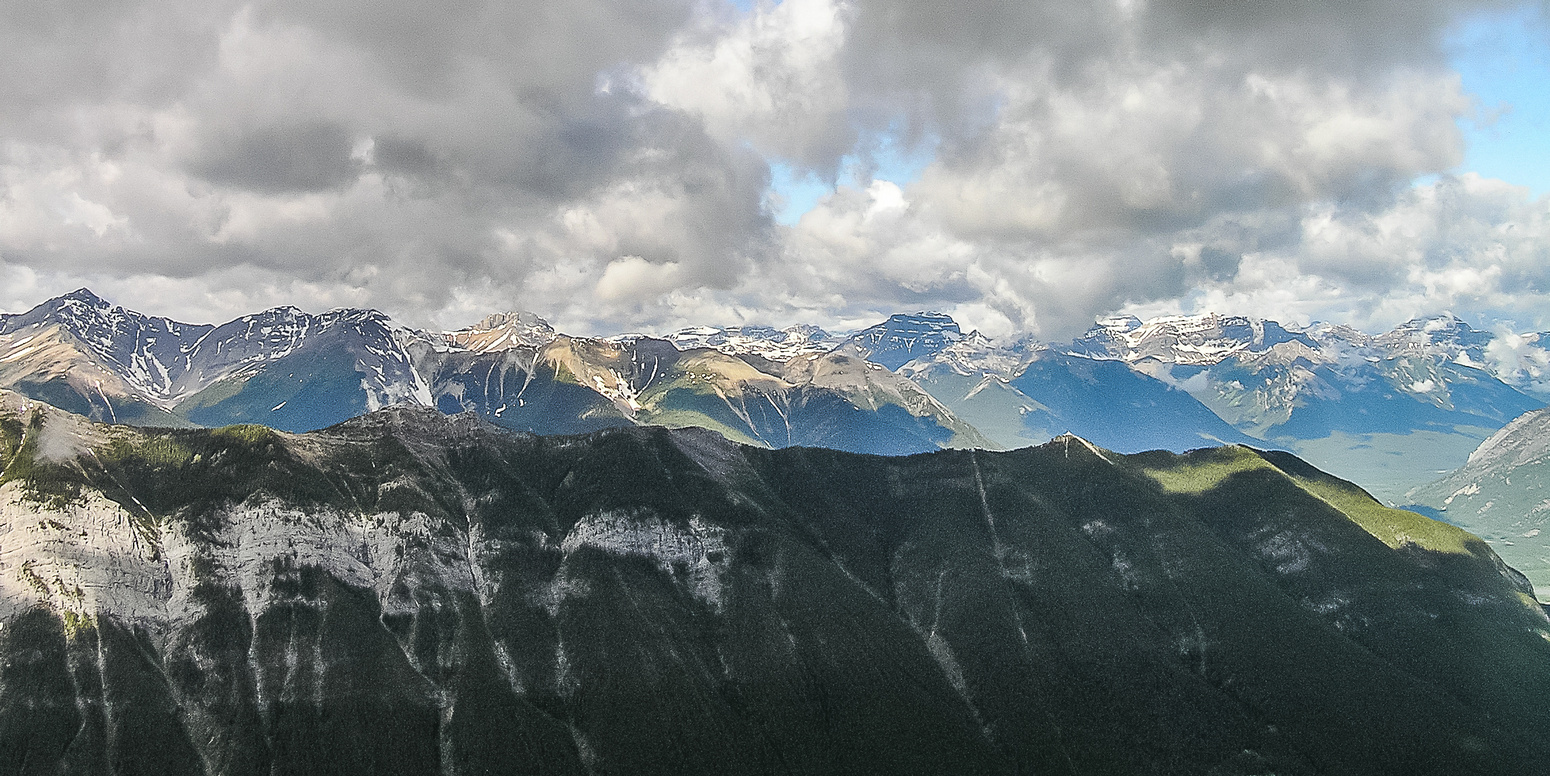 Views over Sulphur Mountain to the Sundance Range and Mount Bourgeau in the distance.