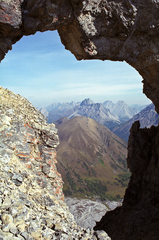 Pocaterra Ridge is perfectly framed through the infamous 'window' in the ridge to the summit of Tyrwhitt.